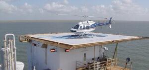 White Blue Helicopter On Helipad