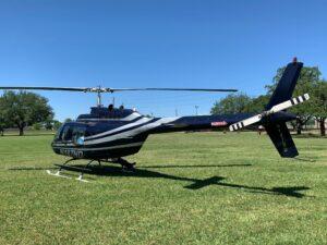 Black Helicopter On Helipad
