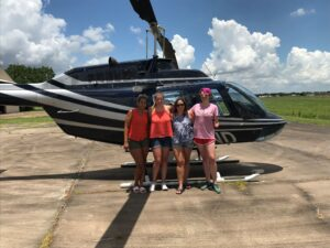 Female Group Standing Near Helicopter