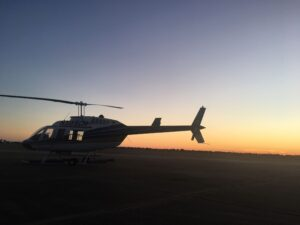 Sunset And White Helicopter